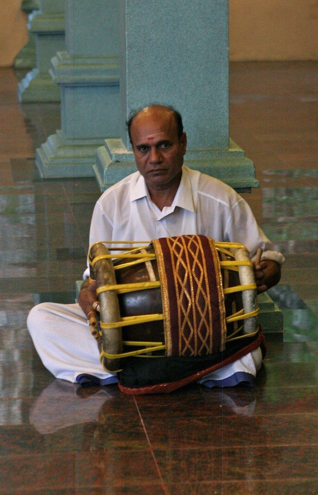 Drummer at Hindu temple at Batu Caves.