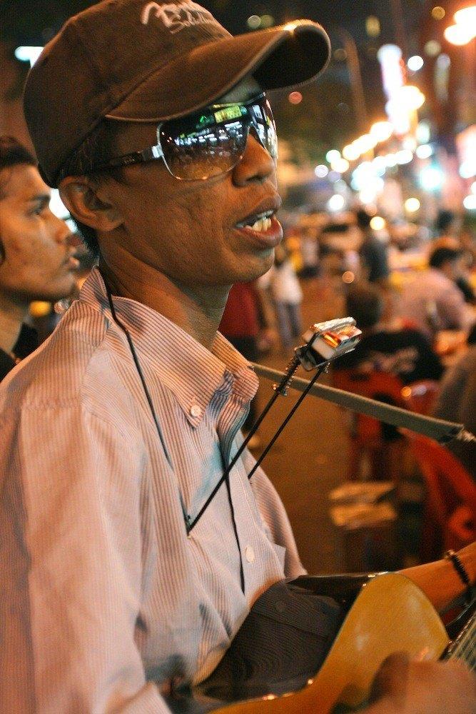 Street musician at Jl Pedaling.