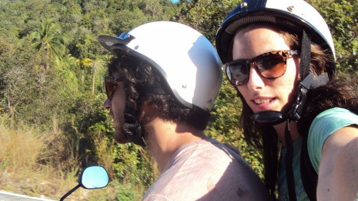 The author and her boyfriend riding safely on their scooter.