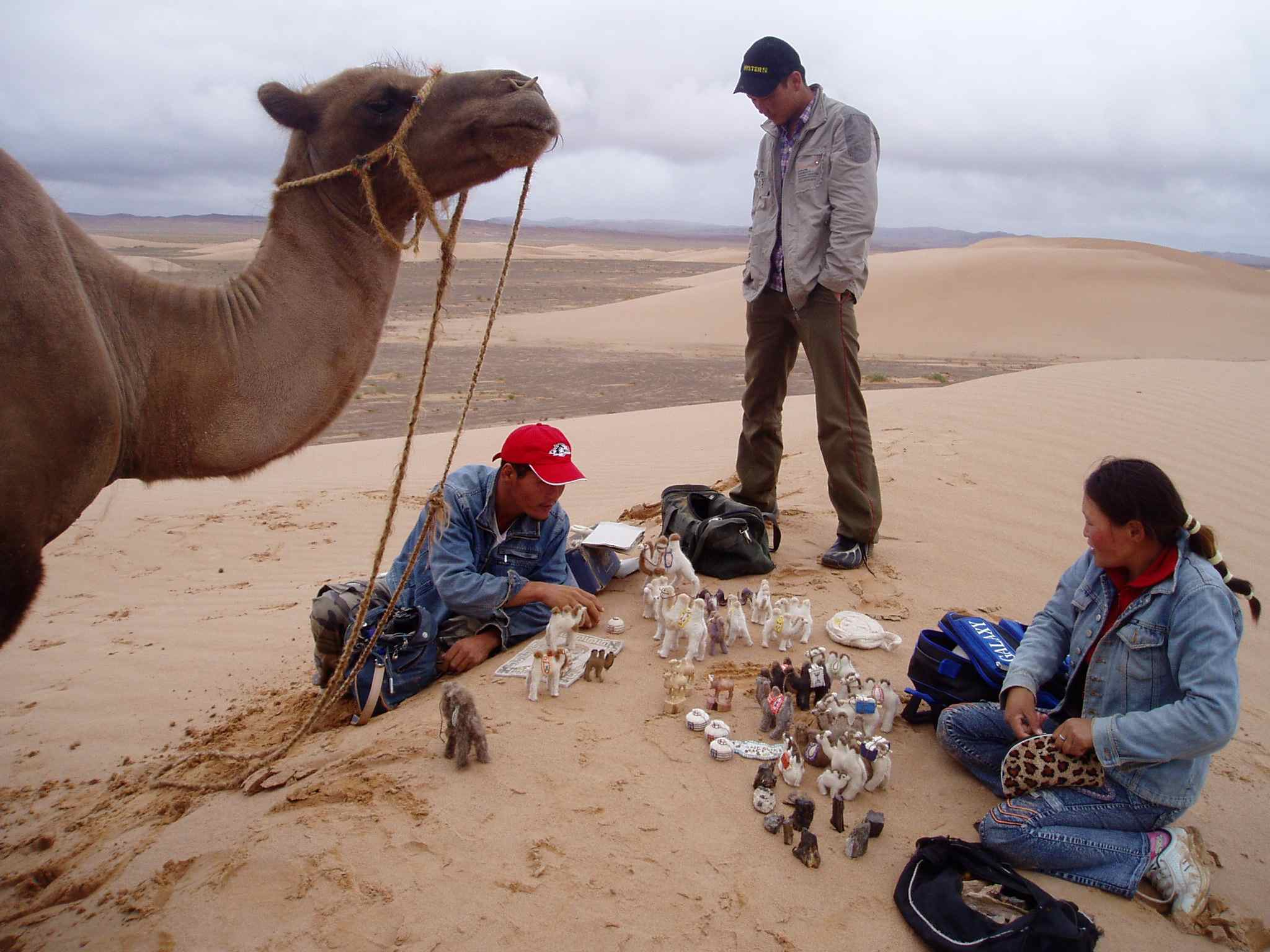 A souvenir salesman who appeared out of nowhere in the middle of the Gobi Desert.