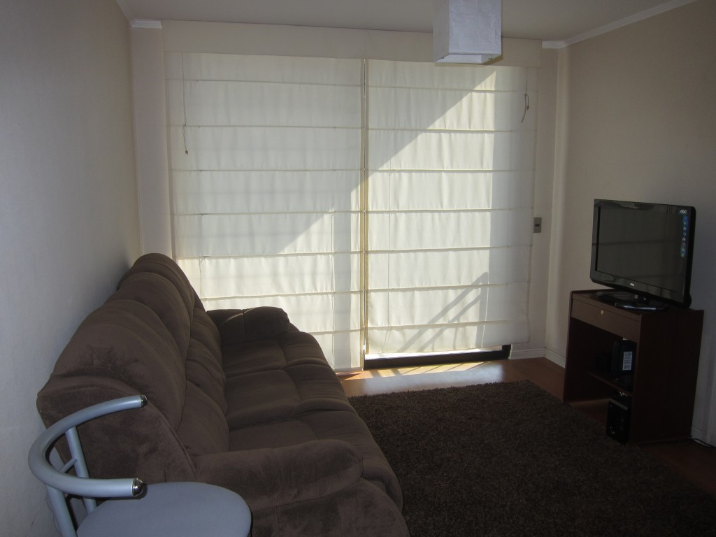 The living room with comfy couch and flat screen TV