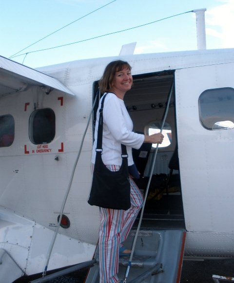 The author (Elaine) boarding a small airplane