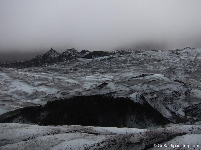 Volcanic ash darkens Sólheimajökull Glacier