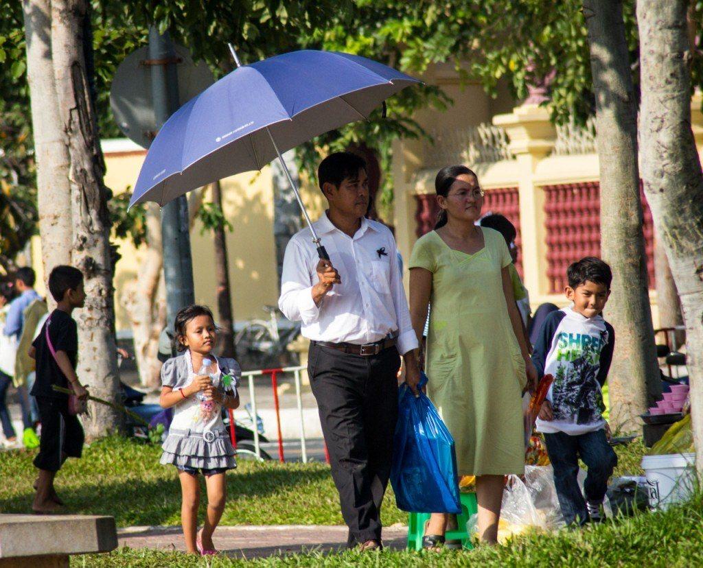 A family walks through Wat Bottom Park