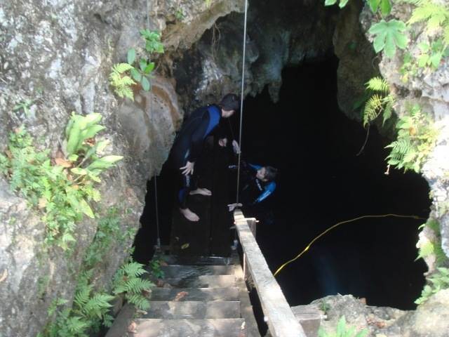 Exiting the cenote after some apres-scuba cliff jumping.