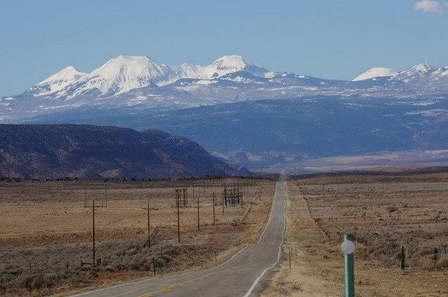 The road stretching to the La Sal Mountains in Utah, near where I got my flat tire.