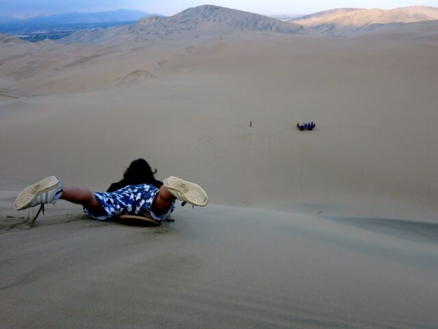 Sandboarding in Huacachina is all about picking up speed.
