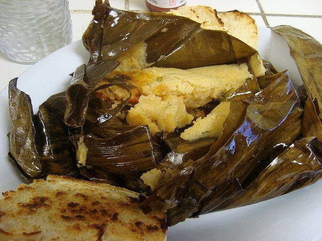 Nacatamal: the Nicaraguan answer to tamales, popular all over the country. Made out of mashed corn and lard, stuffed with either chicken/pork seasoned with tomatoes, onions, garlic (photo: H.C.)