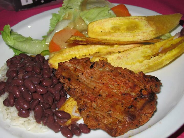 Specially-seasoned Nicaraguan pork with tajadas (fried plantains), rice and beans, salad by the wonderful chefs at Monty's Beach Lodge