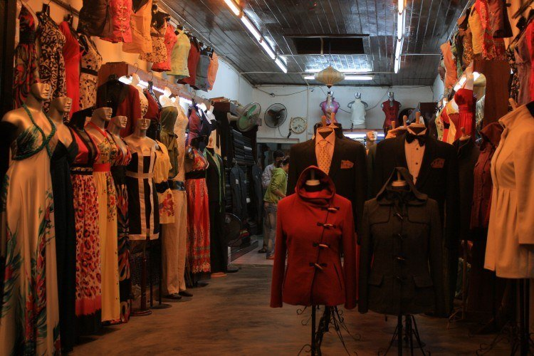 A typical tailor's shop in Hoi An. Image source.