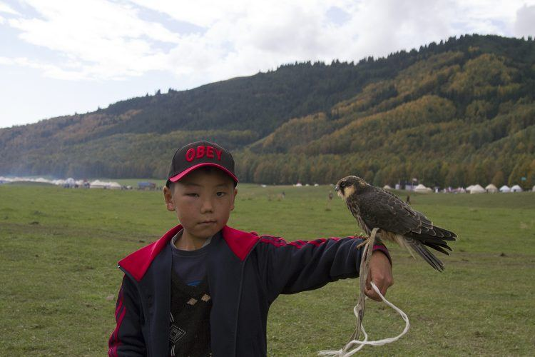 A young Kyrgyz boy who very kindly let me snap a pic of him and his falcon.