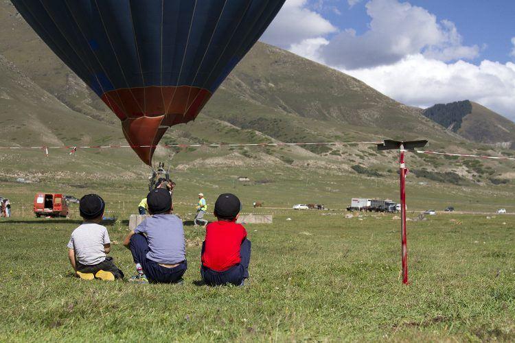 Boys watching the balloon