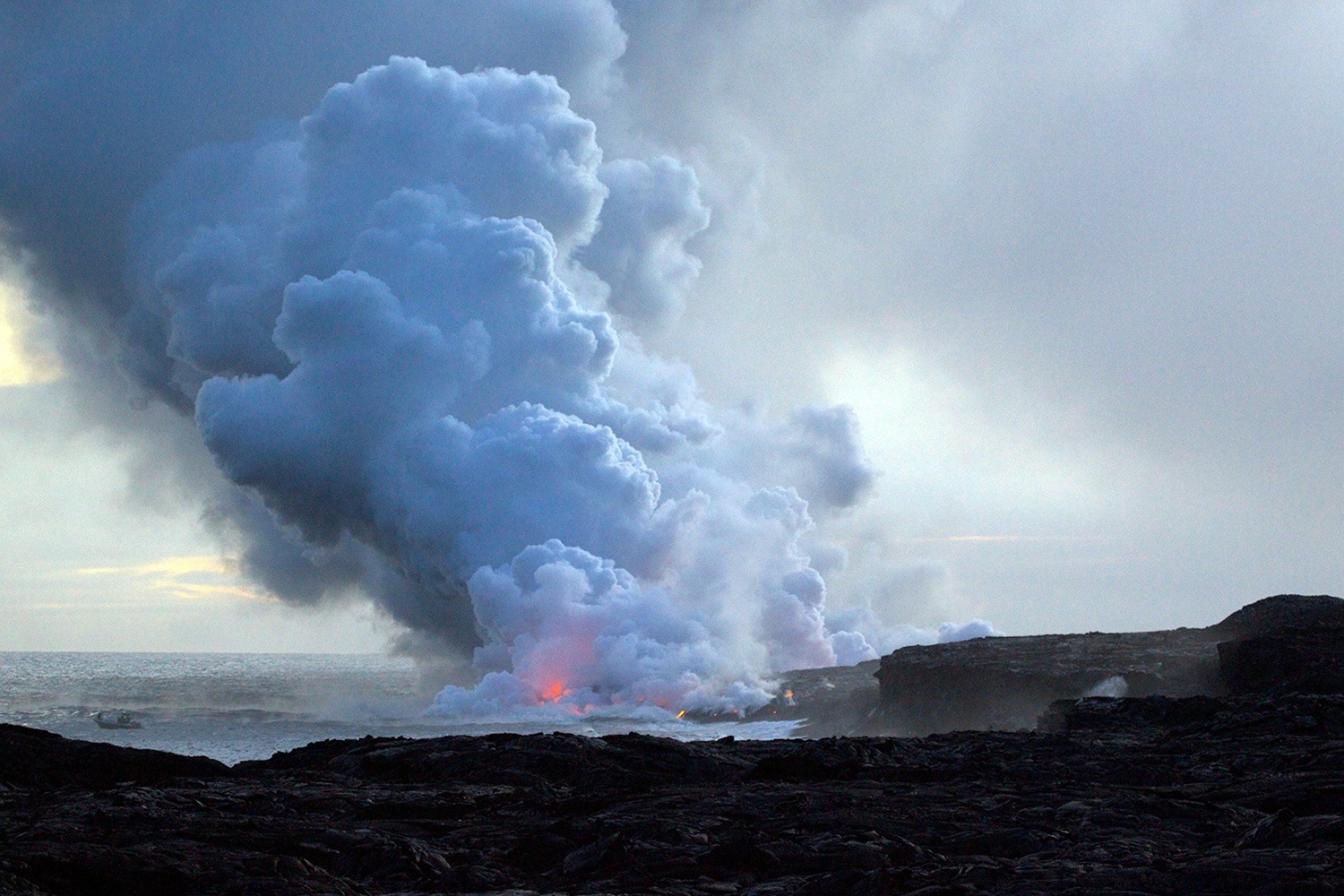 Enjoy the endless flow of lava into the sea at the Hawai'i Volcanoes National Park. (Credit: Matt MacGillivray)