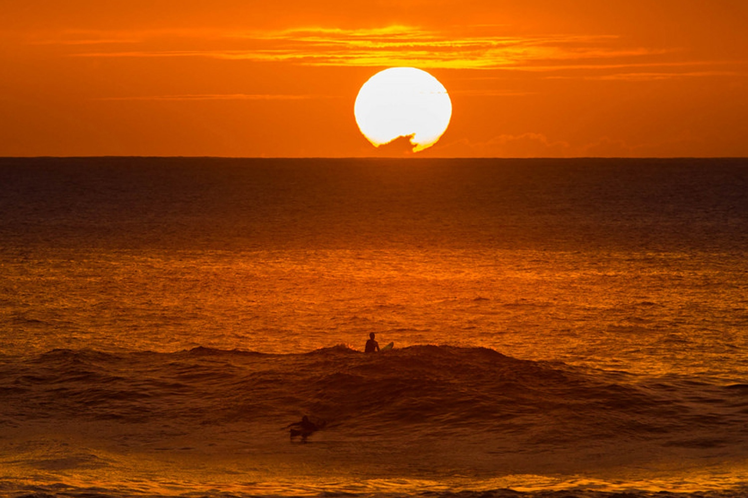 Sunset surfing in Oahu (Credit: Anthony Quintano)