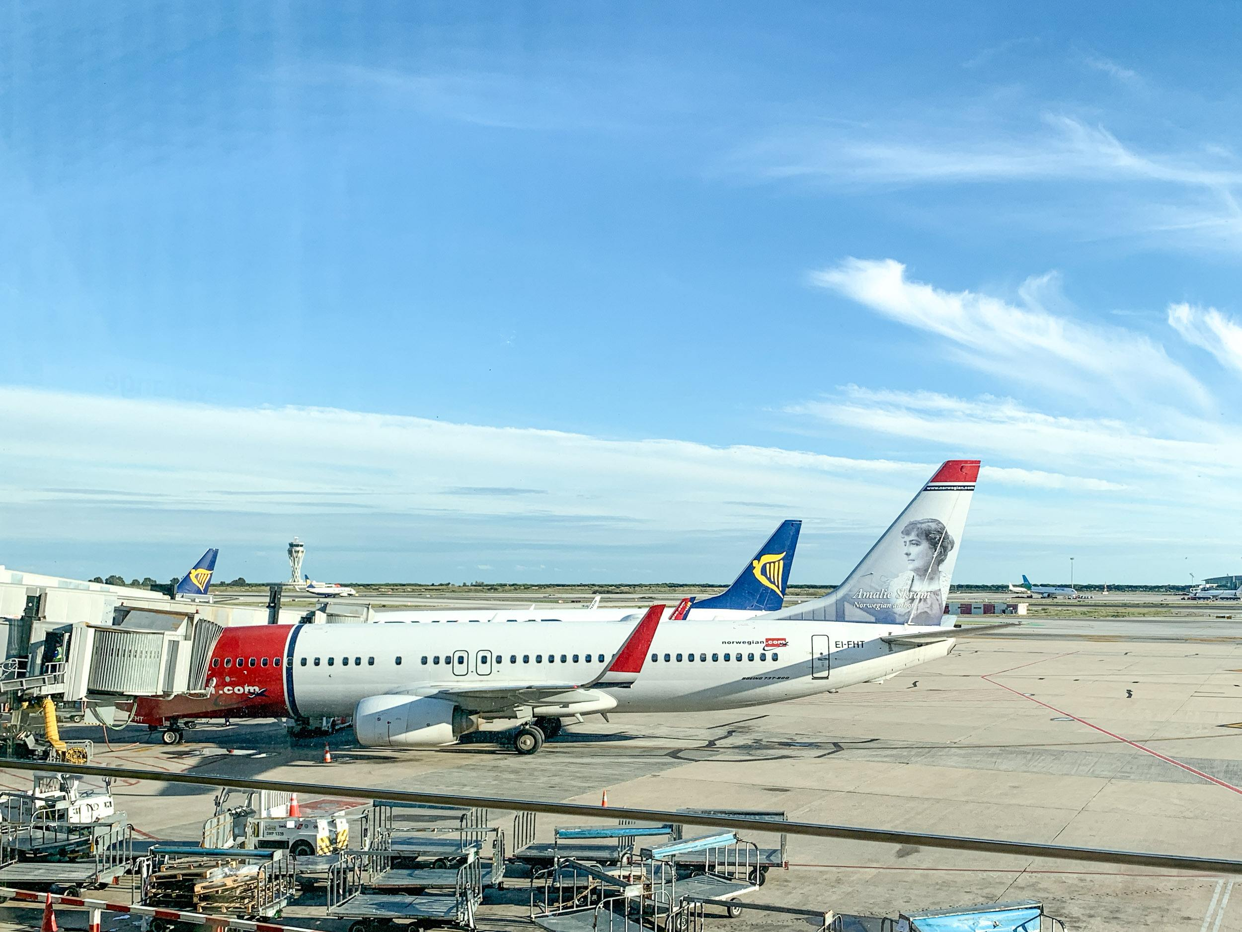 Red and white Norwegian Air 737 at Barcelona airport
