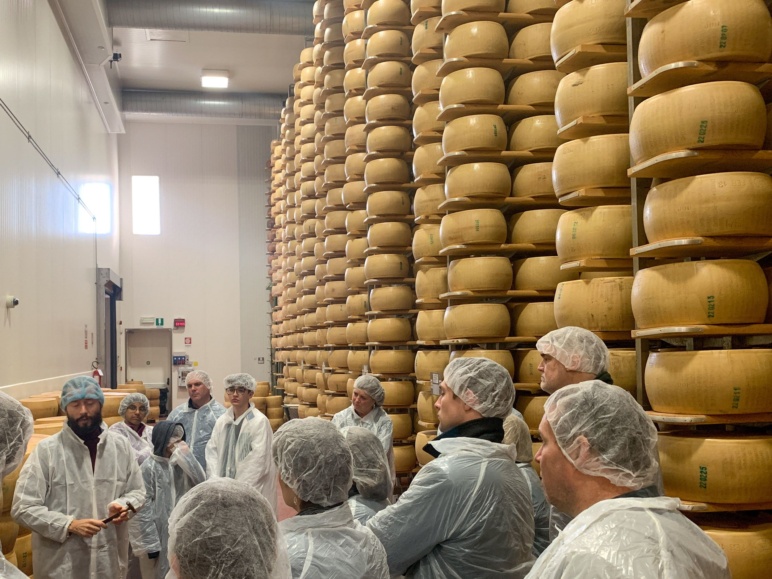 Touring a Parmigiano Reggiano factory is a can't-miss food experience in Emilia-Romagna, Italy.