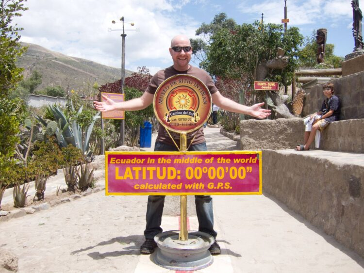 The author at the true Equator, one of the top 10 things to do in Ecuador