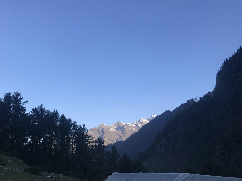 Rays of Sunrise reflecting on the mountains at Kheerganga
