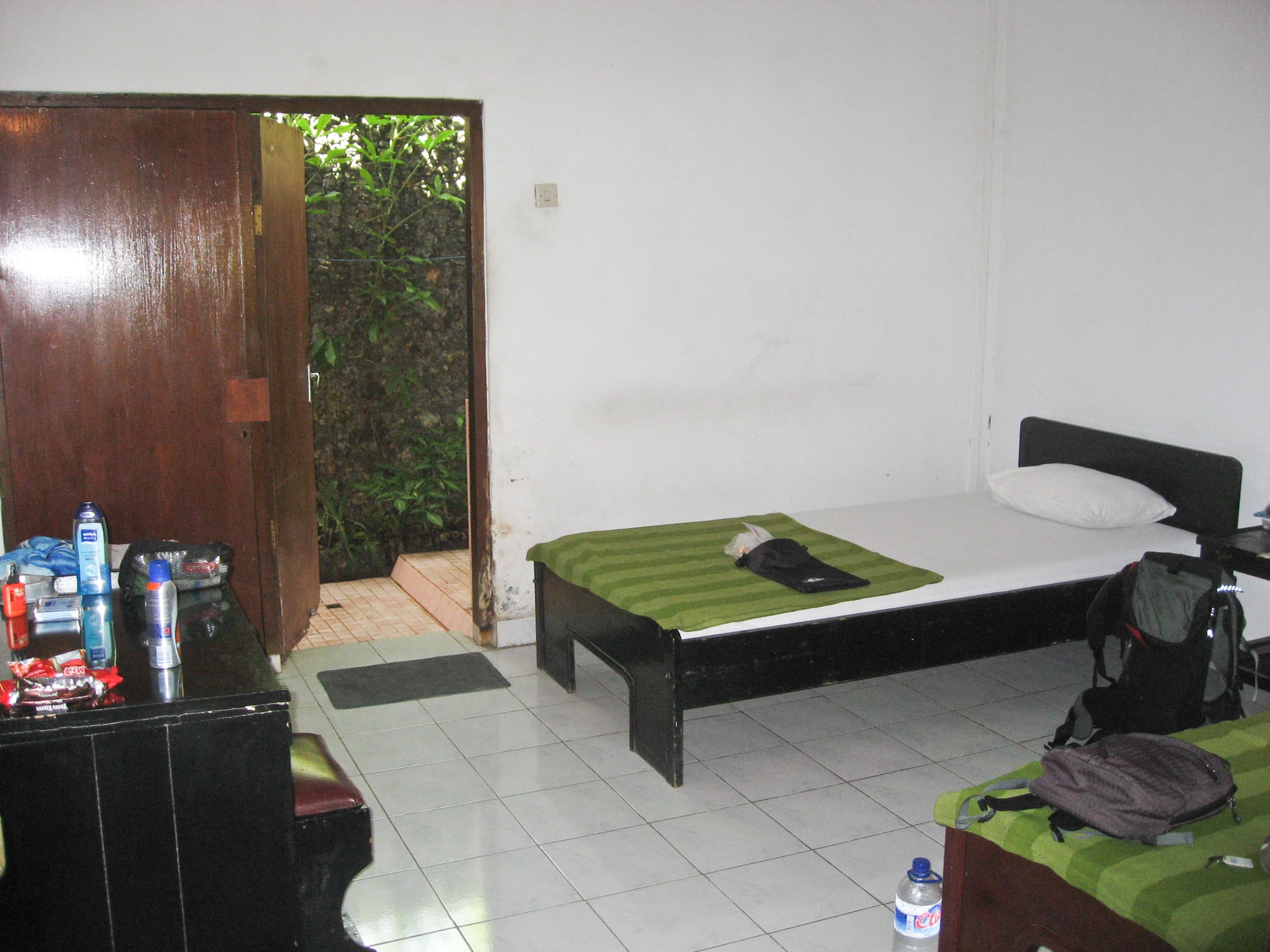 Basic double room on Bali. Staying in cheap places is a way to keep the cost of travel in Indonesia low. (photo: Dave Lee)