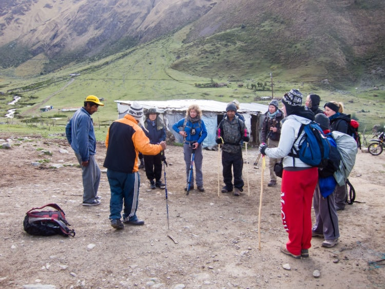 Our guide (orange) briefs us on day two of Salkantay trek to Machu Picchu