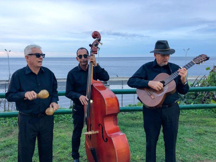 Salsa musicians perform at sunset