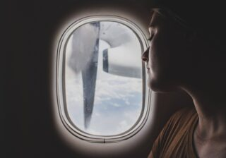 Woman on airplane (photo: Unsplash)