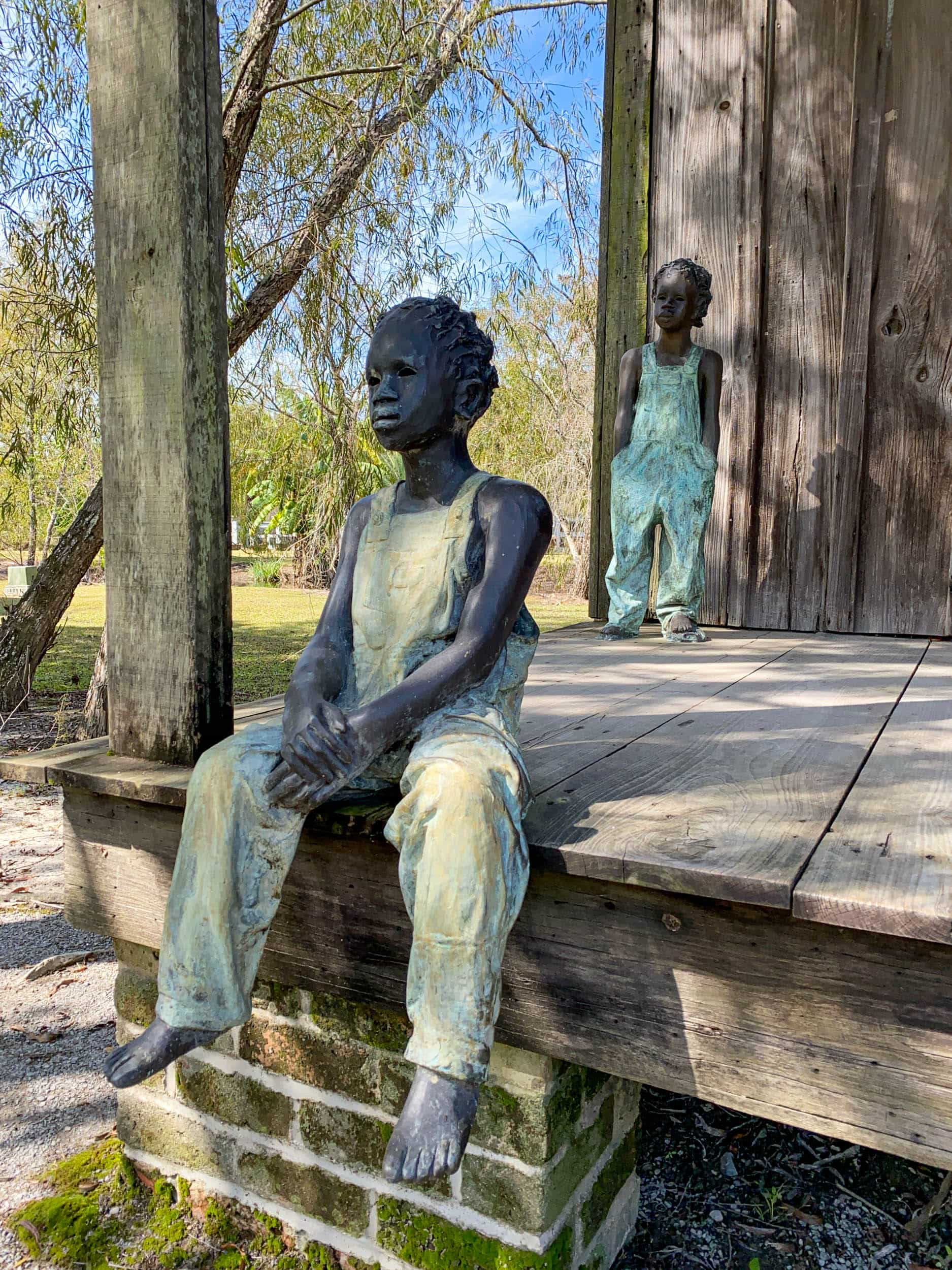 Children of Whitney at a slave cabin