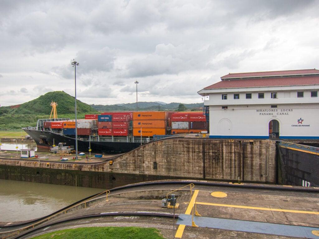 A cargo ship passes through Miraflores Locks, Panama Canal