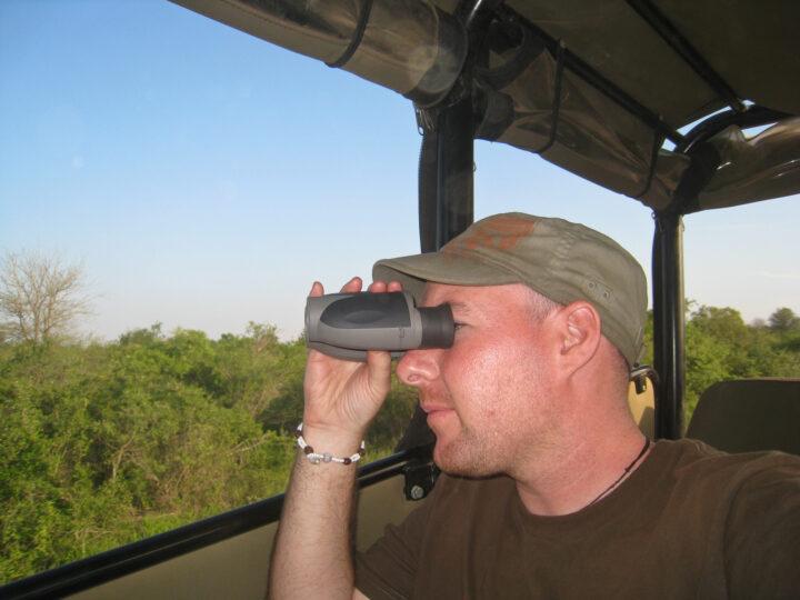 Dave with binoculars on safari in South Africa