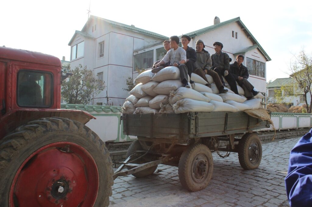 Koreans outside in the Nampho Farm