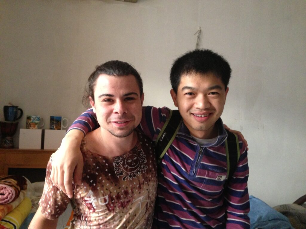 The author (left) and his Couchsurfing host in Beijing, China