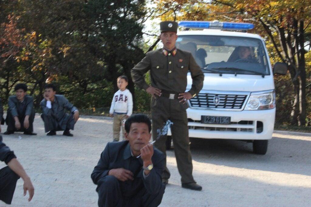 People sitting Kaesong City, DPRK (2013)