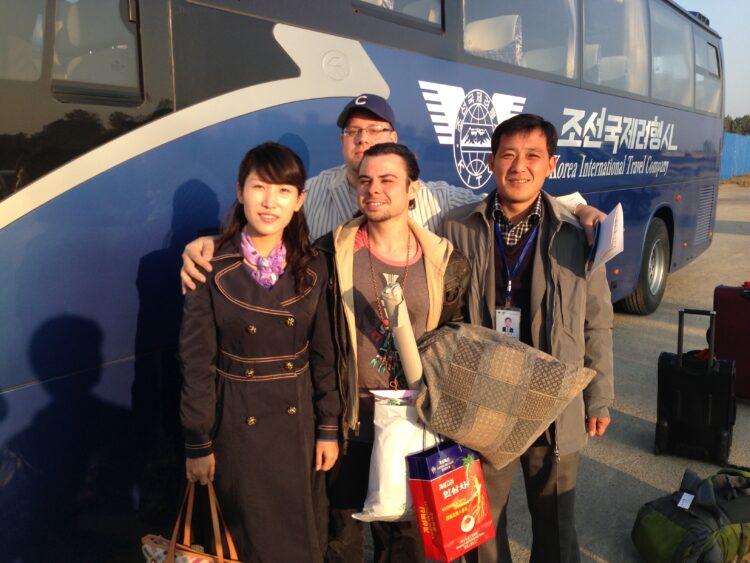 Tourist with North Korean tour guides