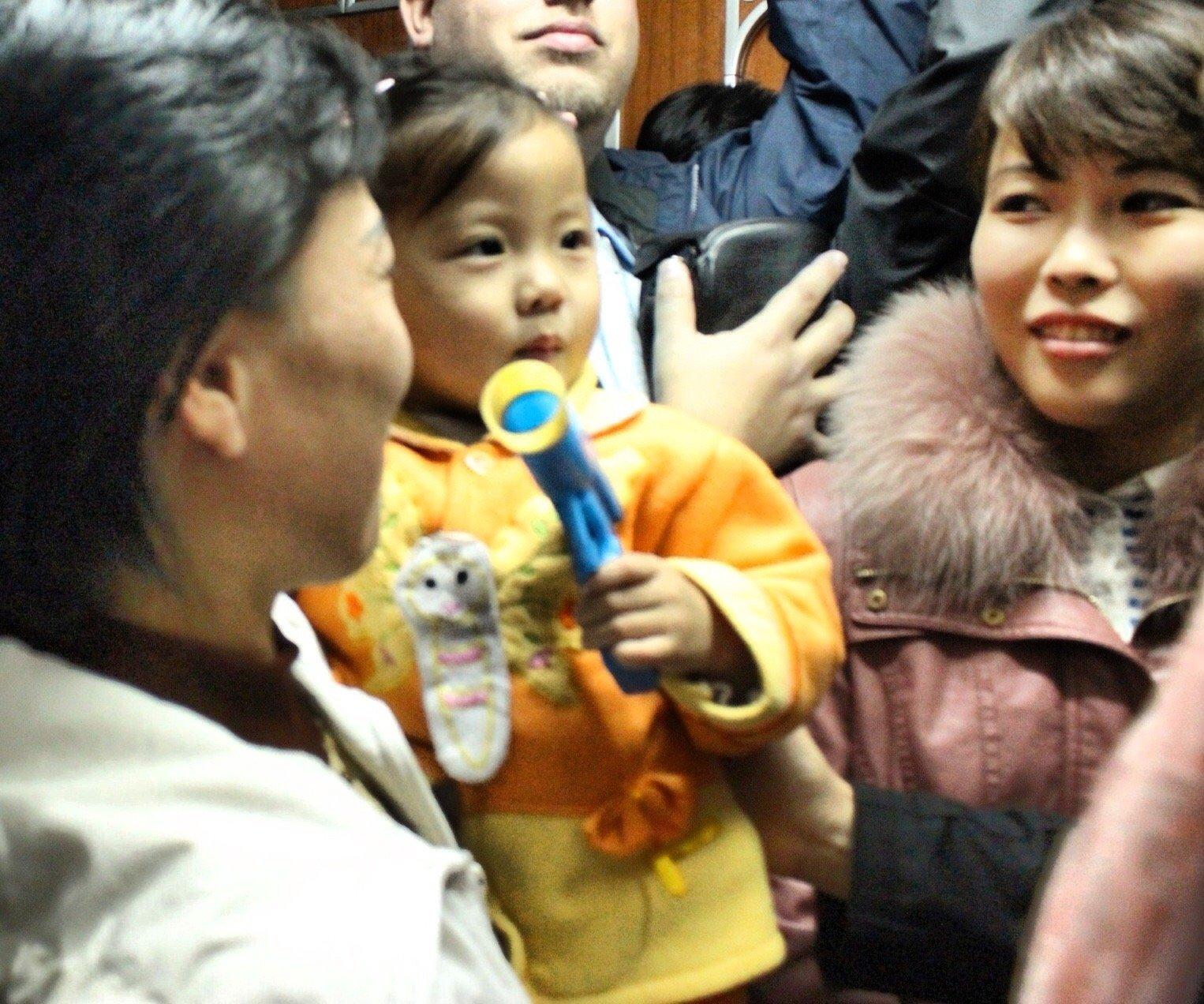 North Koreans on a train