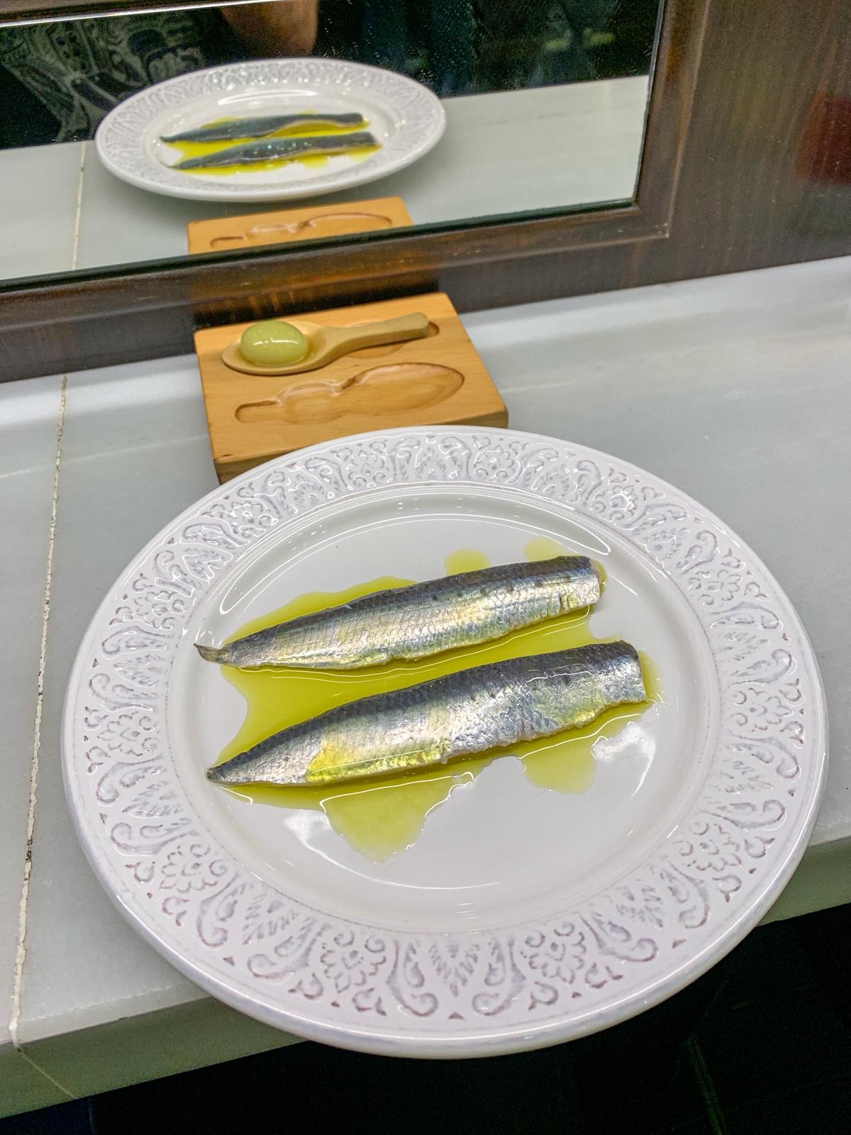 Sardines with olive oil at Bodega 1900 in Barcelona, Spain