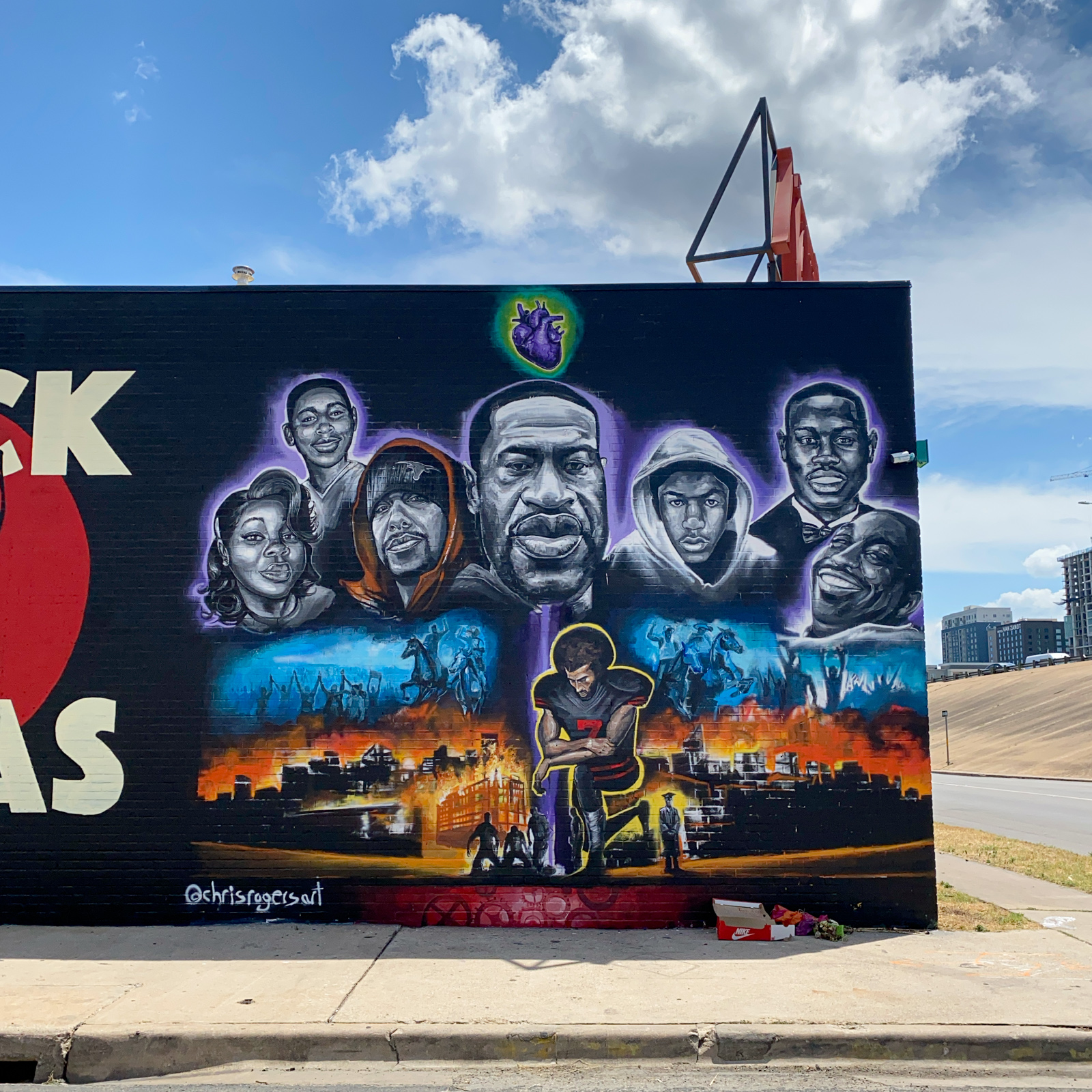 A mural painted in honor of George Floyd and others