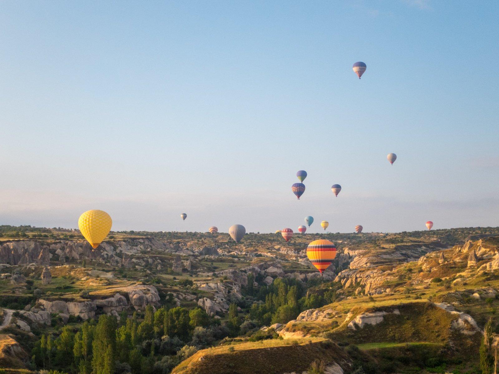 Hot air balloons landing in Cappadocia