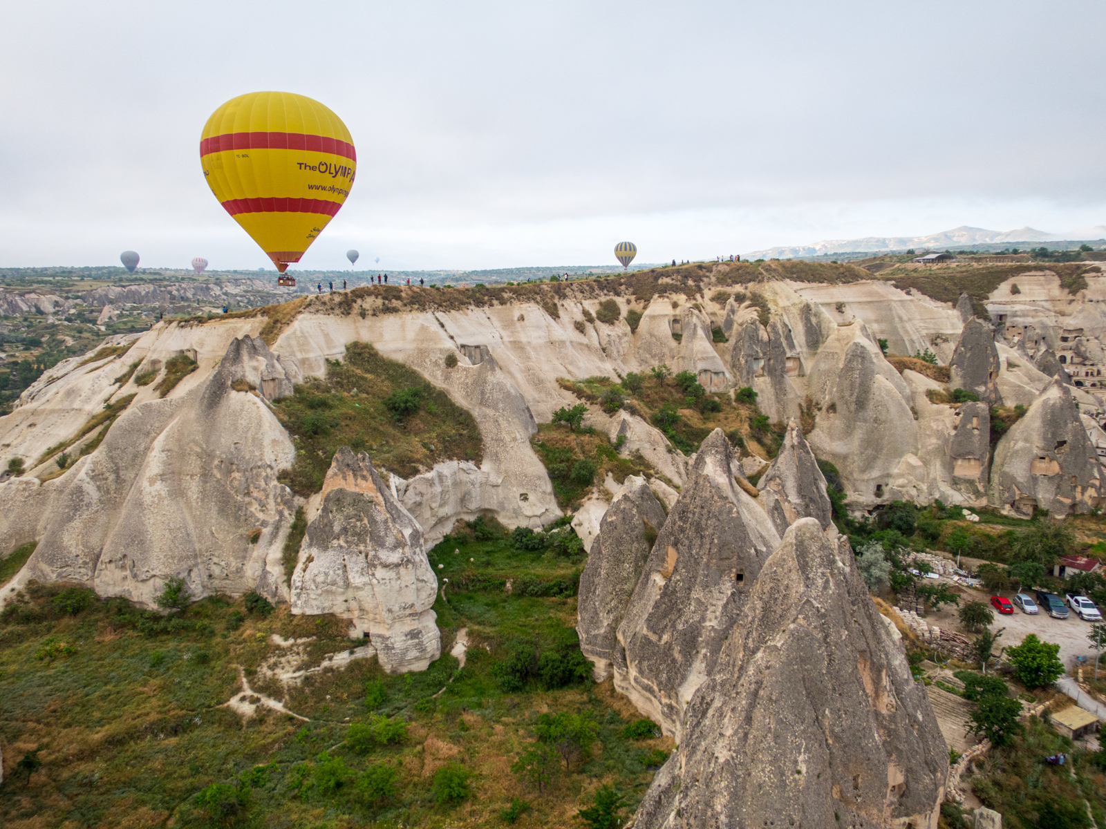 A balloon flies by a scenic outlook