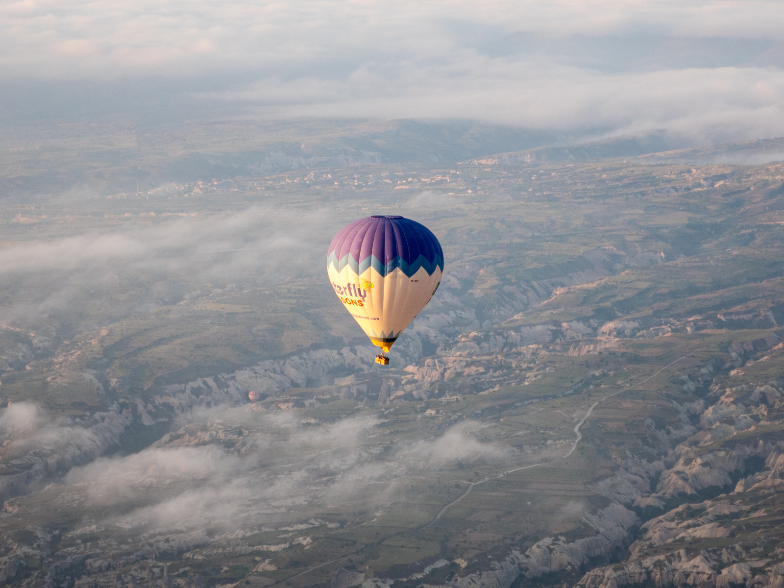 A balloon drifting back to Earth