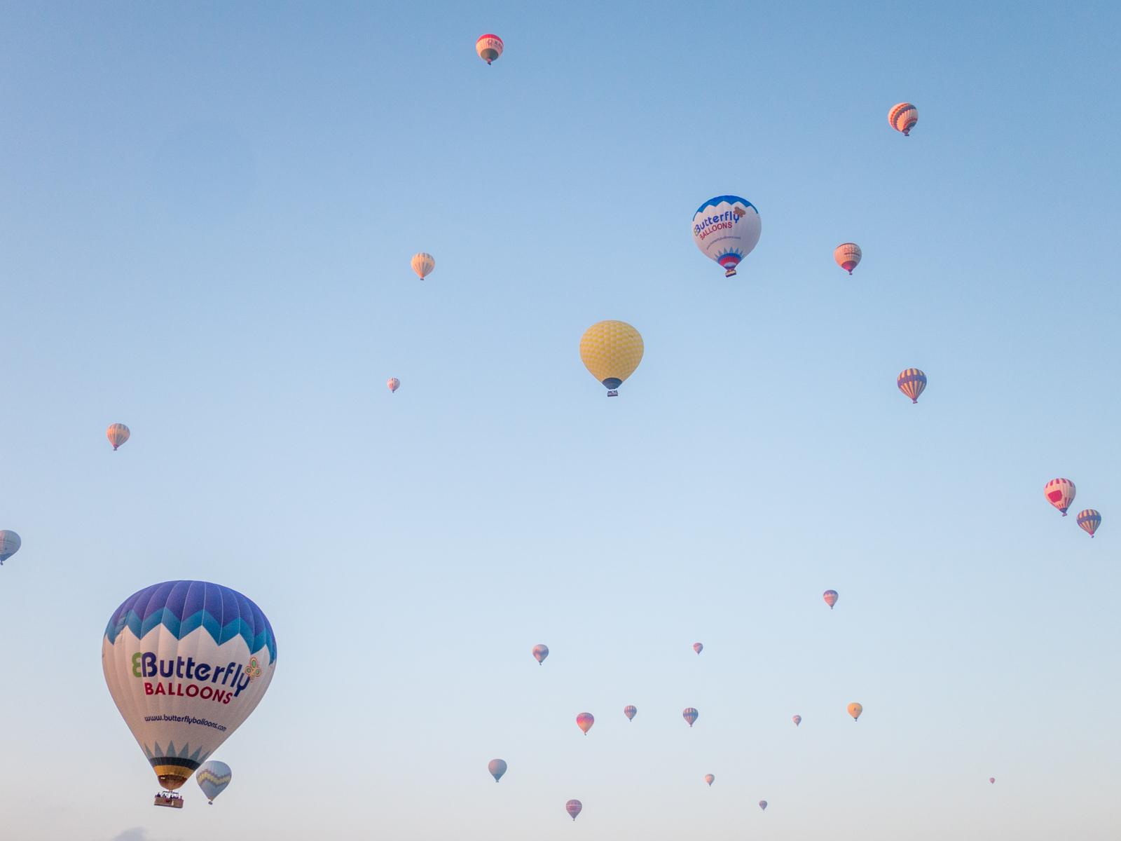 Hot air balloons fill the sky over Cappadocia, Turkey