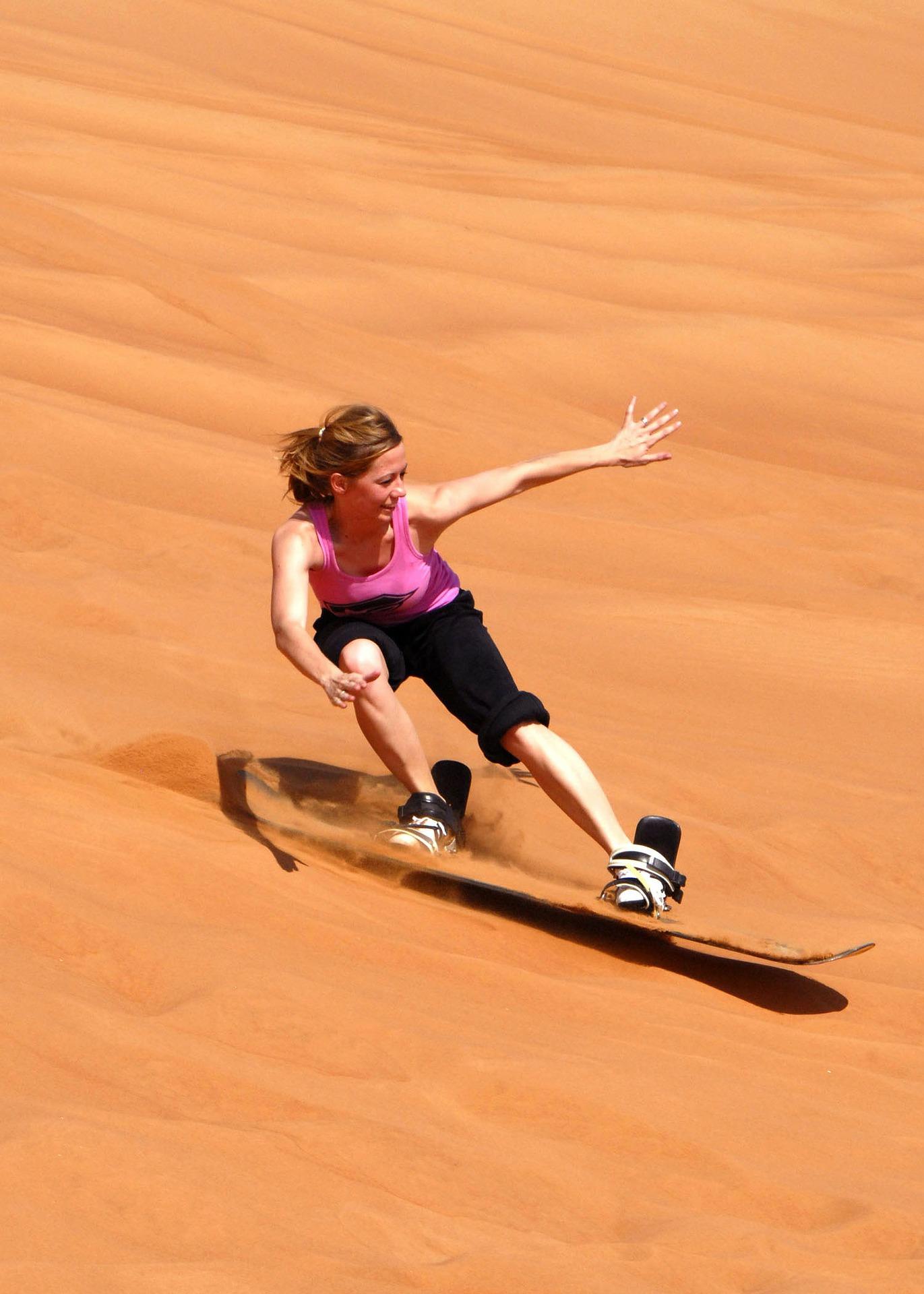 Woman sandboarding in Dubai