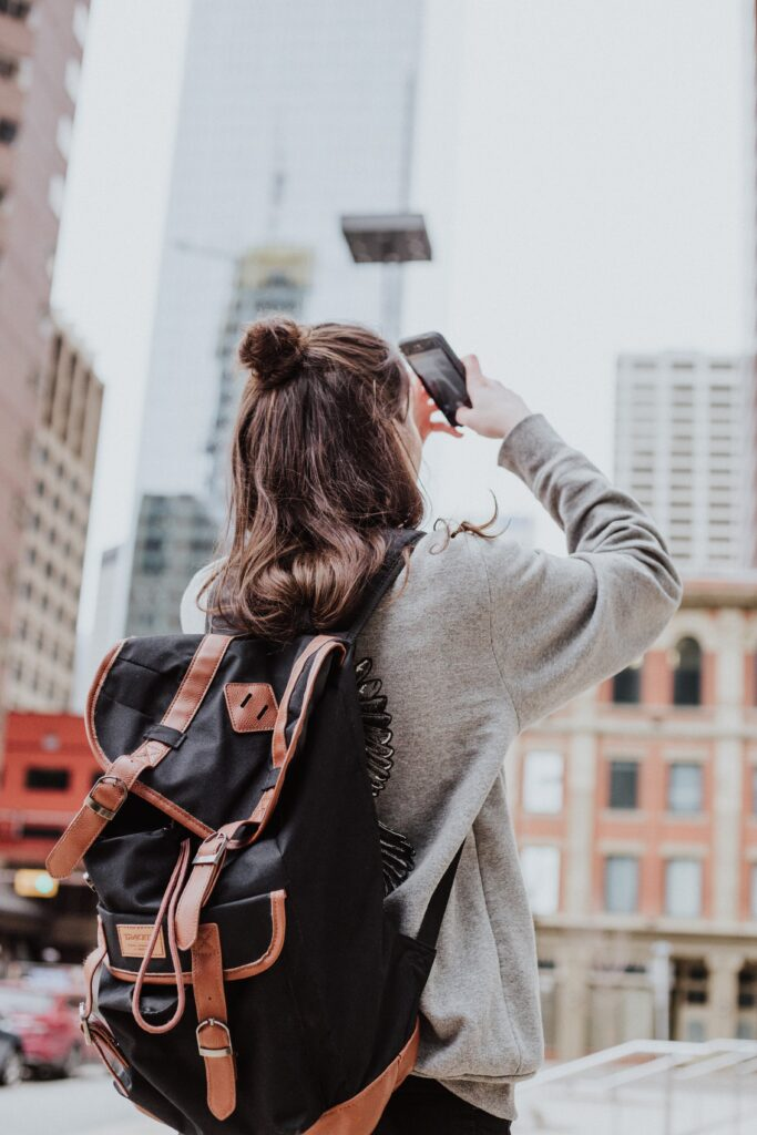 Woman taking a photo with her phone.